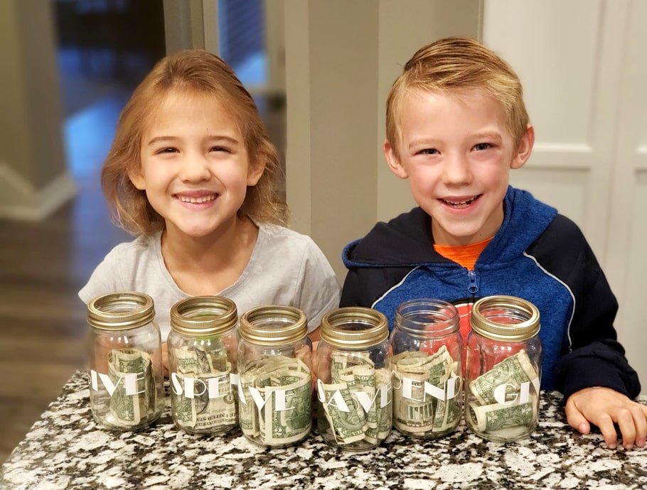 Bunney children with give, save, spend jars